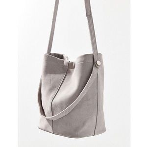 Urban Outfitters grey suede bucket bag purse